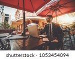 a bearded serious man... | Shutterstock . vector #1053454094
