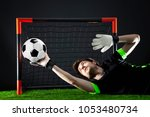 goalkeeper defending goal.... | Shutterstock . vector #1053480734