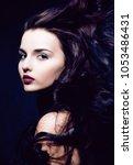 beauty young brunette woman... | Shutterstock . vector #1053486431