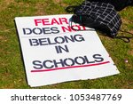 backpack and sign on ground at... | Shutterstock . vector #1053487769
