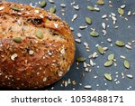 close up of rustic whole grain... | Shutterstock . vector #1053488171