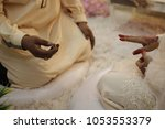 a malay bridegroom  holds his... | Shutterstock . vector #1053553379