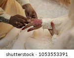 a malay bridegroom  holds his... | Shutterstock . vector #1053553391