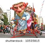Big funny dolls in Cyprus carnival parade. - stock photo
