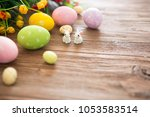 easter rabbit with easter eggs... | Shutterstock . vector #1053583514