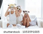 mom with her daughters making... | Shutterstock . vector #1053591005