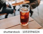 ice americano at a cafe | Shutterstock . vector #1053596024