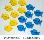 two groups of blue and yellow... | Shutterstock . vector #1053658097
