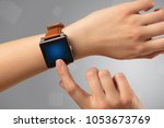 female hand wearing smartwatch... | Shutterstock . vector #1053673769