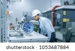 in high tech futuristic factory ... | Shutterstock . vector #1053687884