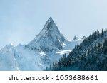 snowy mountain peak | Shutterstock . vector #1053688661
