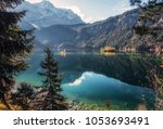 Small photo of Wonderful summer landscape. Sunny day in Alps. Incredible mountain lake Eibsee in Autumn. Popular locations for Photographers. Natural background. Garmisch-Partenkirchen. Bavarian alp, Germany. Europe