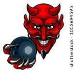 a devil cartoon character... | Shutterstock .eps vector #1053694595