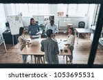 going over details. top view of ...   Shutterstock . vector #1053695531