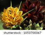 chocolate flowers sculptures of ... | Shutterstock . vector #1053700367