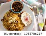 fired rice on white plate | Shutterstock . vector #1053706217