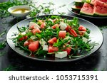 fresh juicy watermelon arugula... | Shutterstock . vector #1053715391