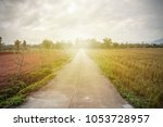 concrete road in the... | Shutterstock . vector #1053728957