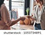 buying and selling. close up of ... | Shutterstock . vector #1053734891