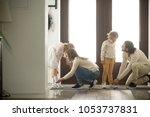 parents helping children son... | Shutterstock . vector #1053737831