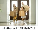 excited kids holding boxes... | Shutterstock . vector #1053737984