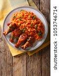nigerian food party  jollof... | Shutterstock . vector #1053746714