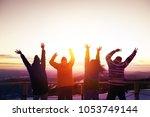 group of happy friends is... | Shutterstock . vector #1053749144