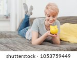cheerful young woman holding... | Shutterstock . vector #1053759449