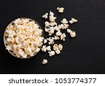black bowl with fresh salted... | Shutterstock . vector #1053774377