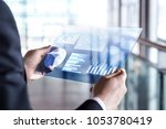transparent futuristic tablet.... | Shutterstock . vector #1053780419