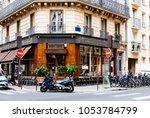 cozy street with flower shop... | Shutterstock . vector #1053784799