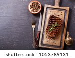 grilled meat with rosemary on... | Shutterstock . vector #1053789131