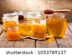 various types of honey in glass ... | Shutterstock . vector #1053789137