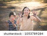 happy asian children playing... | Shutterstock . vector #1053789284