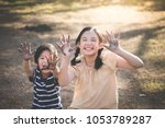 happy asian children playing... | Shutterstock . vector #1053789287
