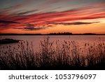 Crimson Sunset On The...