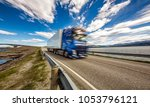 truck rushes down the highway... | Shutterstock . vector #1053796121