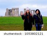 overseas tourists  stonehenge ... | Shutterstock . vector #1053802121