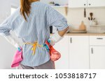 tired young woman standing at... | Shutterstock . vector #1053818717