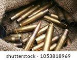 ammunition during war  | Shutterstock . vector #1053818969