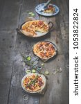 different delicious quiches on... | Shutterstock . vector #1053822824
