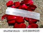 selenite crystal on lush rose... | Shutterstock . vector #1053849035