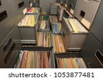 Small photo of Important documents arranged in a file placed in a filing cabinet.