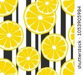 fresh lemons background. hand... | Shutterstock .eps vector #1053905984