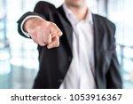 boss giving order or firing... | Shutterstock . vector #1053916367