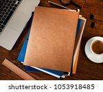 manila folders on desk   Shutterstock . vector #1053918485