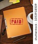 paid folders on desk  | Shutterstock . vector #1053918509