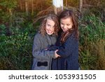 happy girlfriends cuddle and... | Shutterstock . vector #1053931505