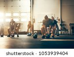 focused group of fit people... | Shutterstock . vector #1053939404