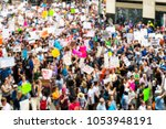 Stock photo thousands march in texas to protest gun violence in schools blurred background 1053948191